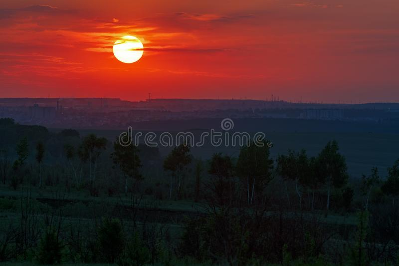 Sunset over the horizon in a cloudy sky.  royalty free stock image