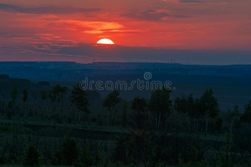 Sunset over the horizon in a cloudy sky.  stock photo