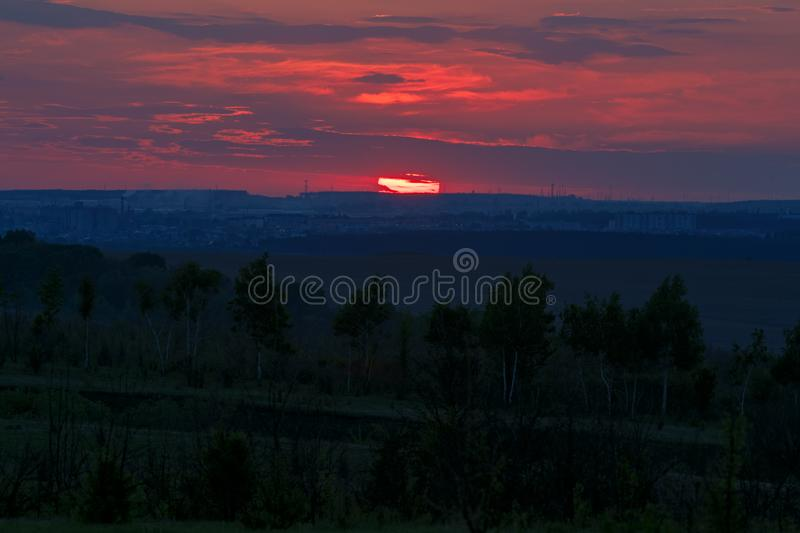 Sunset over the horizon in a cloudy sky.  stock images