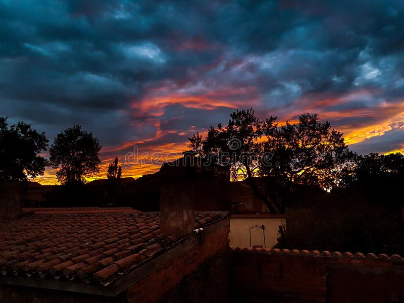 sunset over houses royalty free stock images