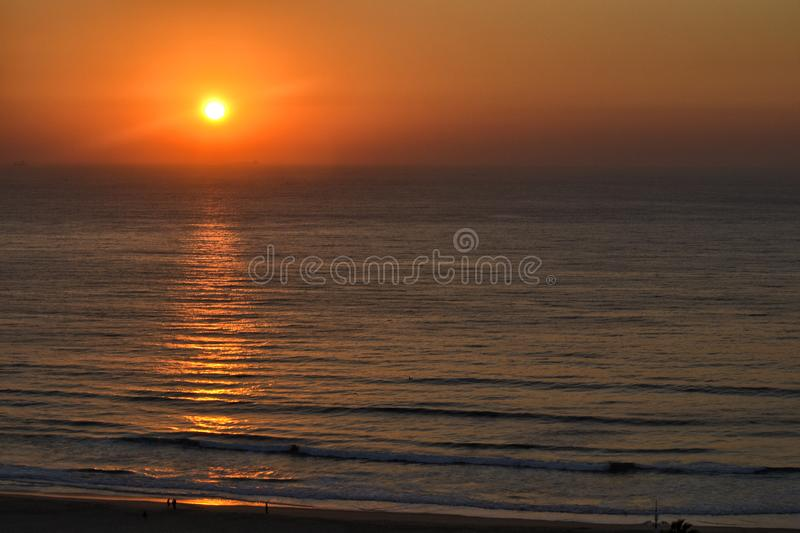 Sunset over the Indian ocean. And the Durban South Africa beach stock images