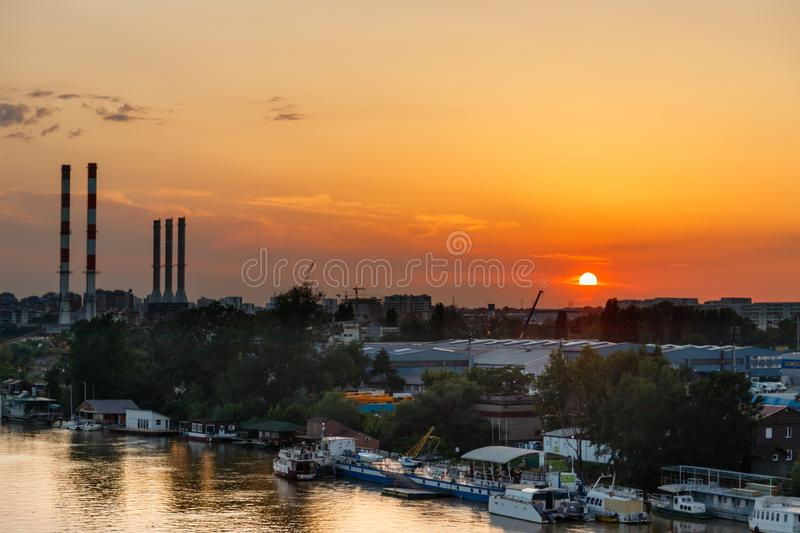 Sunset over the industrial part of the town royalty free stock photo
