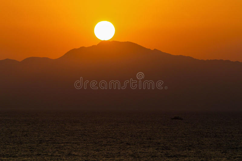 Sunset over an island in the Red Sea stock photos