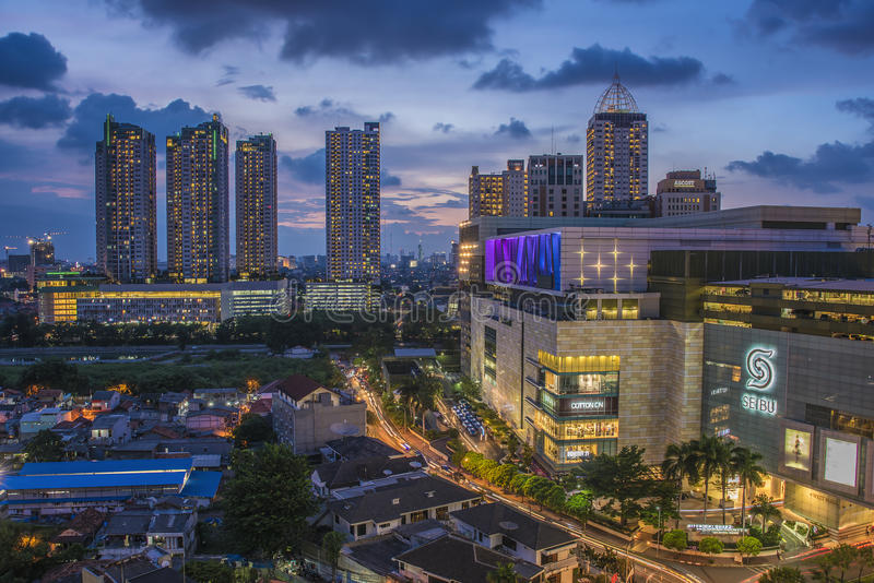 Sunset over Jakarta. Jakarta cityscape next to famous shopping mall Grand Indonesia stock image