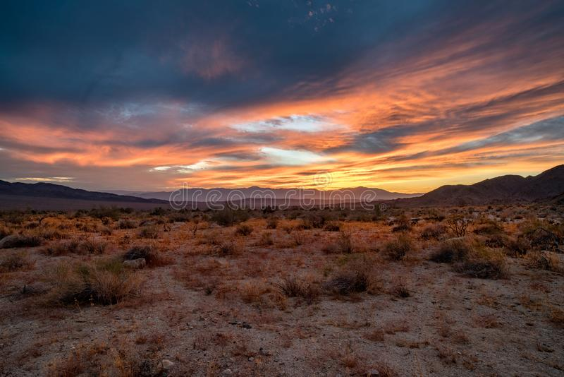 SUNSET OVER JOSHUA TREE NATIONAL PARK. MOUNTAIN VIEW, DESERT VIEW, COLORFUL SKIES royalty free stock photo