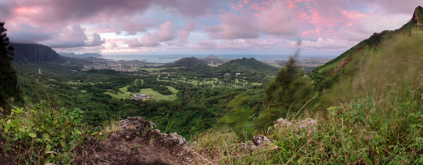 Sunset over Kaneohe. The sun sets over Kaneohe from Pali lookout on O'ahu island Hawaii stock image