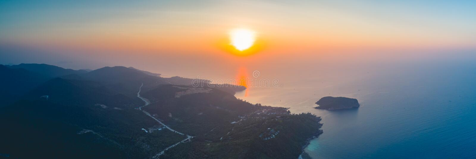Sunset over Ko Pha-ngan island, ocean. Thailand. Panorama sunset sky, ocean, island. Aerial drone shot. Thailand. Breathtaking scene the bright sunset over the royalty free stock photo