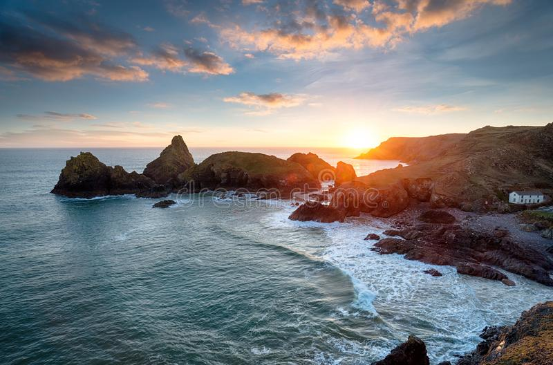 Sunset at Kynance Cove in Cornwall. Sunset over Kynance Cove on the Lizard Peninsula in Cornwall royalty free stock photos