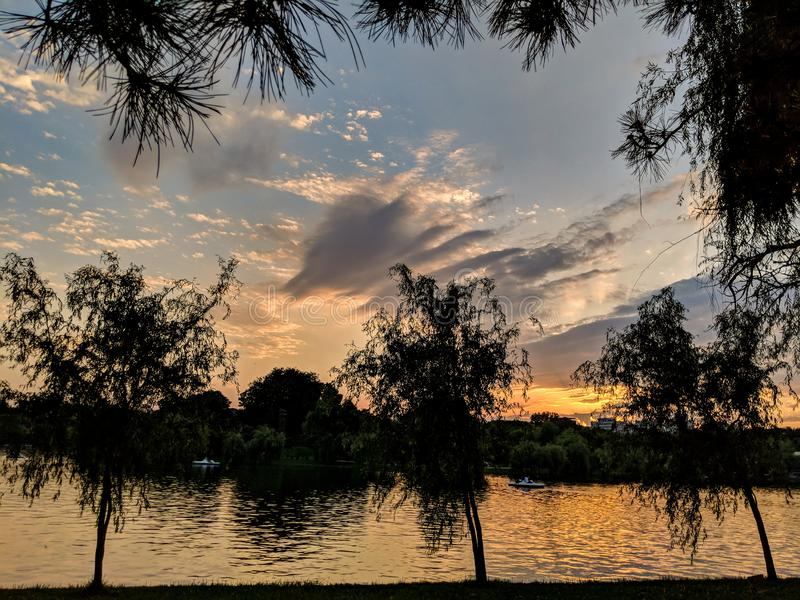 Sunset over the lake in Alexandru Ioan Cuza Park, Bucharest royalty free stock image