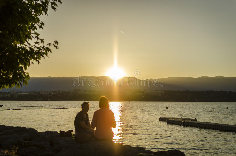 Sunset over the Lake of Geneva. Beautiful sunsets of Geneva enjoyed by people around the lake Leman. No clouds, summer time stock images