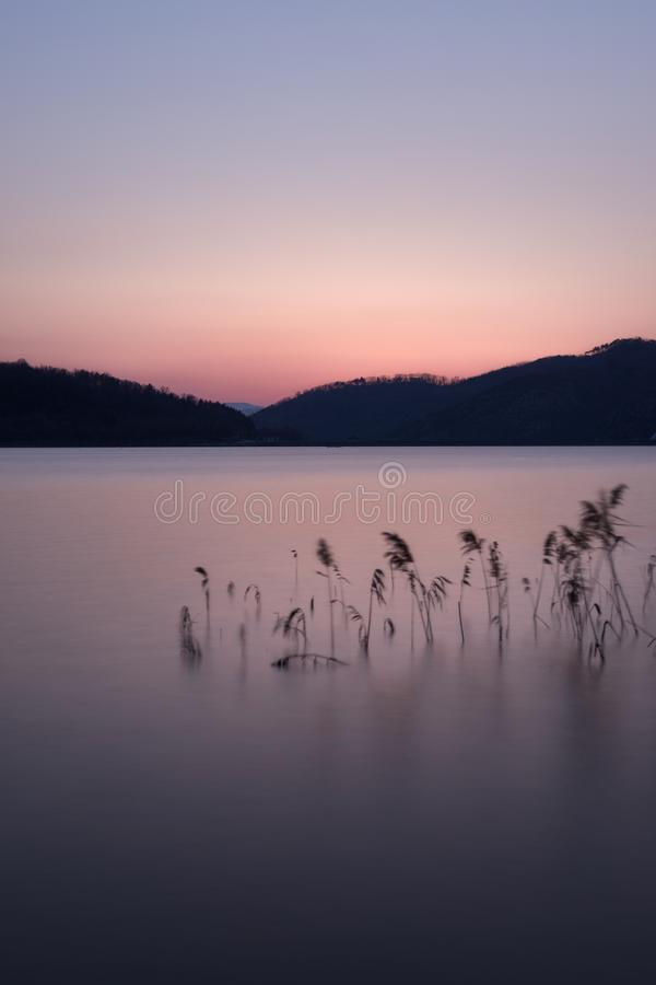 Sunset over hillside in Gyeongju, South Korea. Sunset over lake in hillside of Gyeongju, South Korea royalty free stock photos