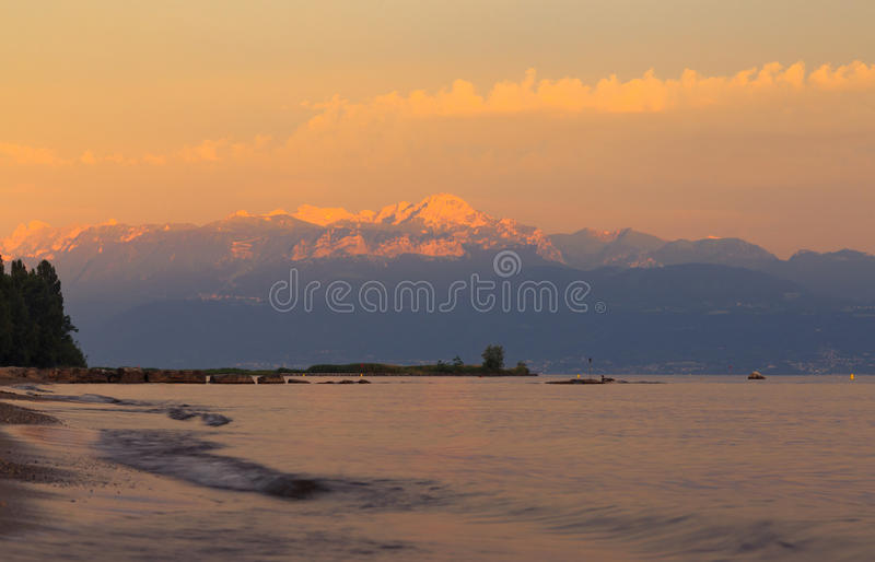 Sunset over the lake Leman and the part of Alps. On the background. Lausanne Switzerland stock photos