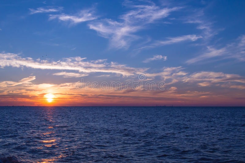 Sunset over Lake Michigan. Chicago skyline can be seen on the horizon. Shot at Indiana Dunes National Lakeshore royalty free stock photos
