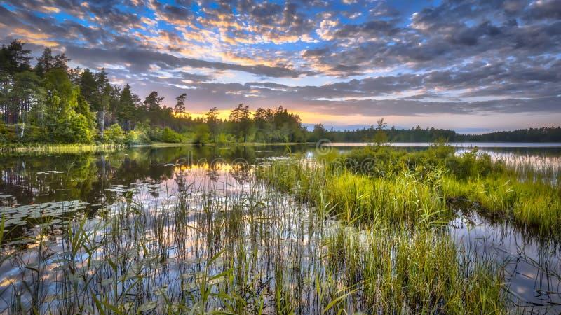 Sunset over lake Nordvattnet in Hokensas. Nature reserve, Vastergotland, Sweden royalty free stock images