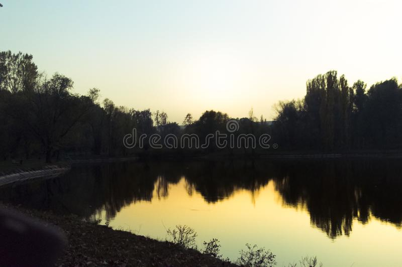Sunset over the lake in the park in the fall royalty free stock photos