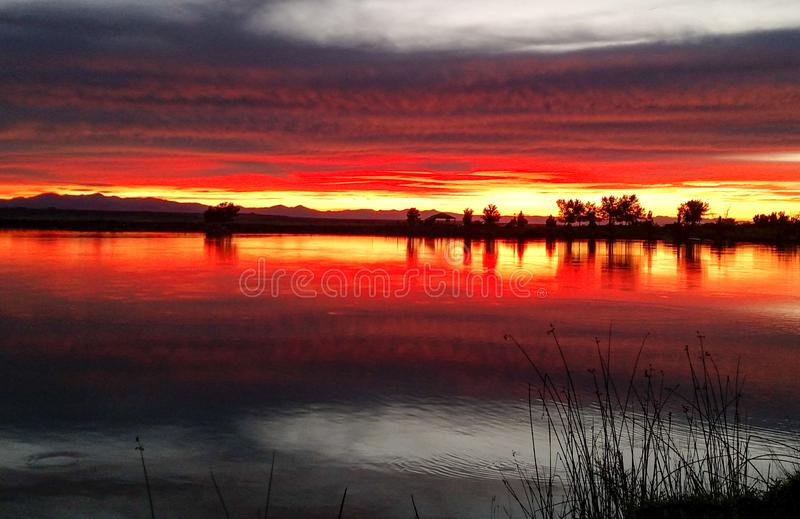 Sunset over lake, Denver, Colorado. Sunset over lake with red skies in rural Denver, Colorado royalty free stock photos