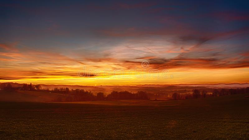 Sunset over landscape - red and yellow clouds in the sky stock photos