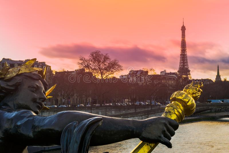 Sunset over the Alexandre III bridge. Sunset over the lanterns of the Pont Alexandre III with the Eiffel Tower in the background royalty free stock images