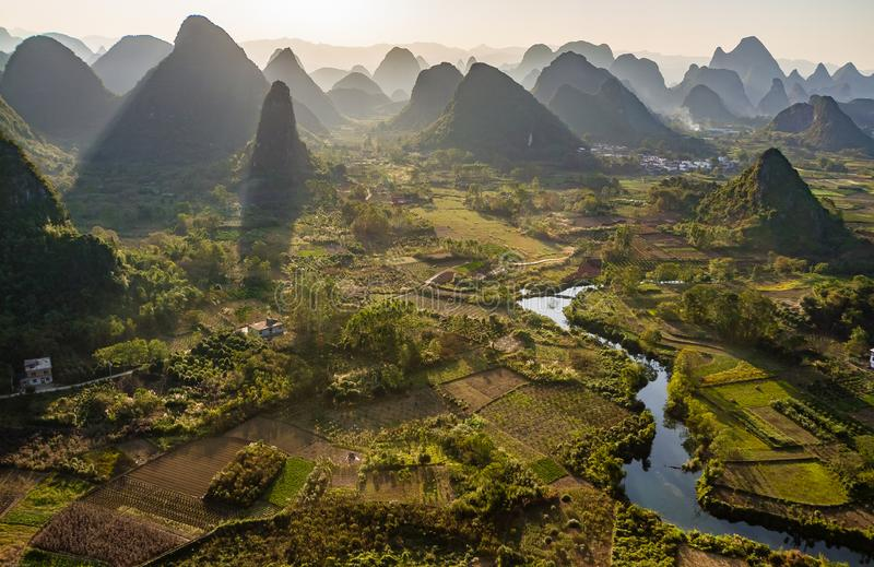 Sunset over Li River, Guilin, China. Sunset overlooking the Li River near Guilin, China. Li River is meandering through rice paddies and around striking green stock images