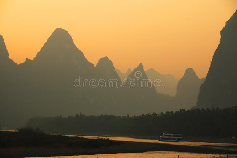 Sunset over the Li river at Xingping, Guilin stock photography