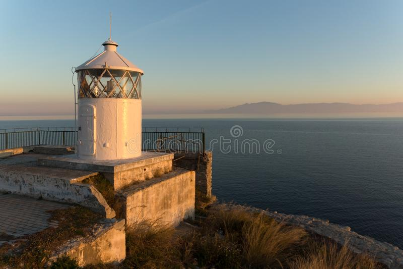 Sunset over Lighthouse in Kavala, East Macedonia and Thrace, Greece. KAVALA, GREECE - DECEMBER 27, 2015: Sunset over Lighthouse in Kavala, East Macedonia and stock image
