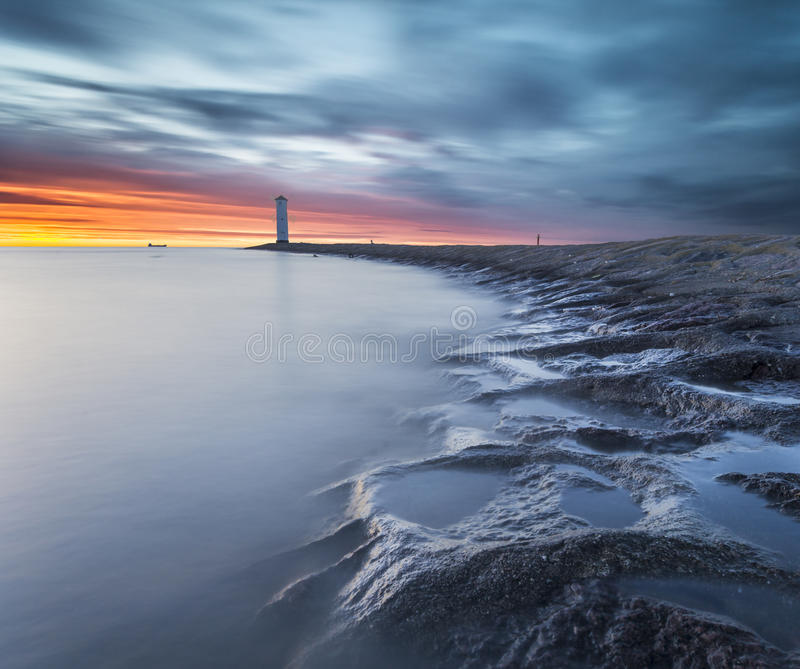 Sunset over the lighthouse Stawa Mills, Swinoujscie stock image