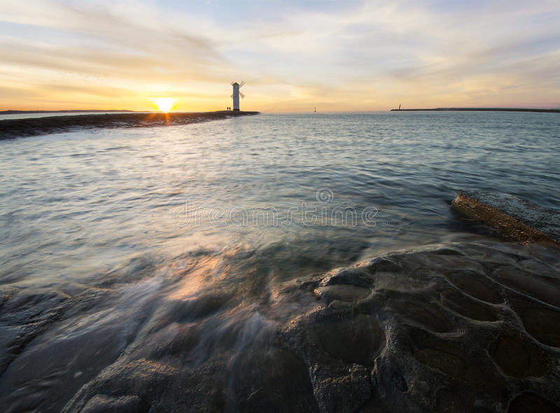 Sunset over the lighthouse Stawa Mills, Swinoujscie. Poland stock images