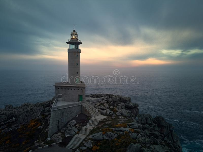 Sunset over a lighthouse royalty free stock photography