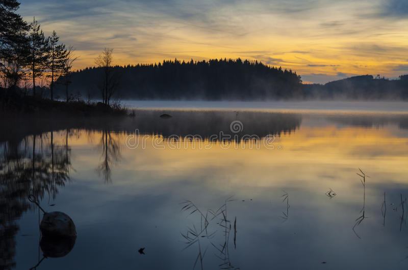 Sunset over a lake in Sweden stock photos
