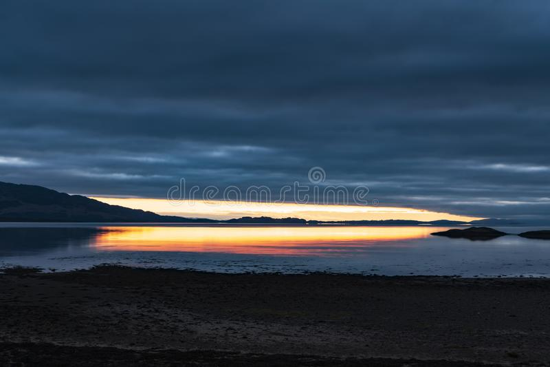 Linnhe Sunset. A sunset over Loch Linnhe near the corran narrows and Ardgour, Lochaber, Scotland royalty free stock photo