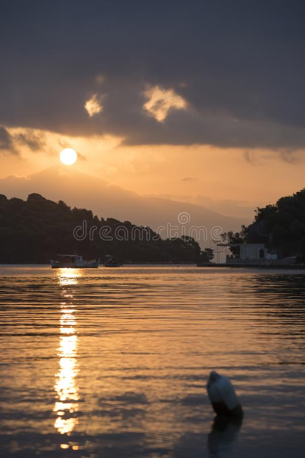Sunset over Madouri, Lefkada, Greece. Scenic landscape at tourist viewpoint. Fishing boat stock images