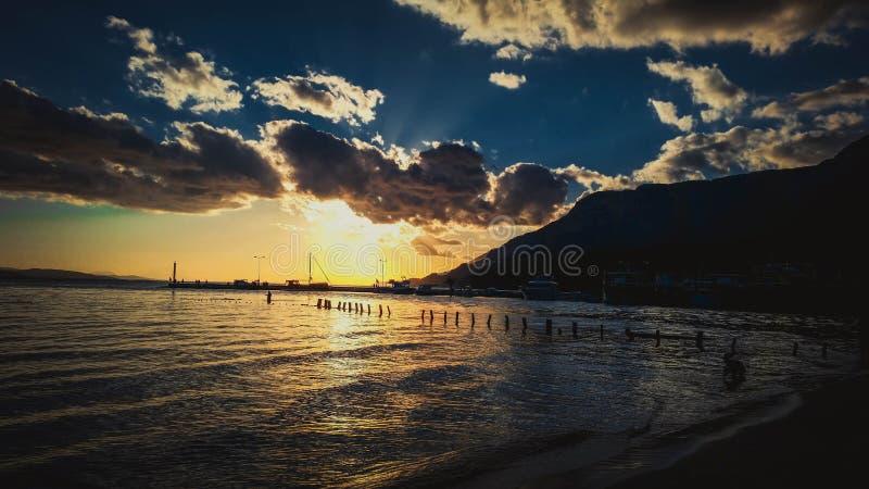 Sunset over marina royalty free stock photography