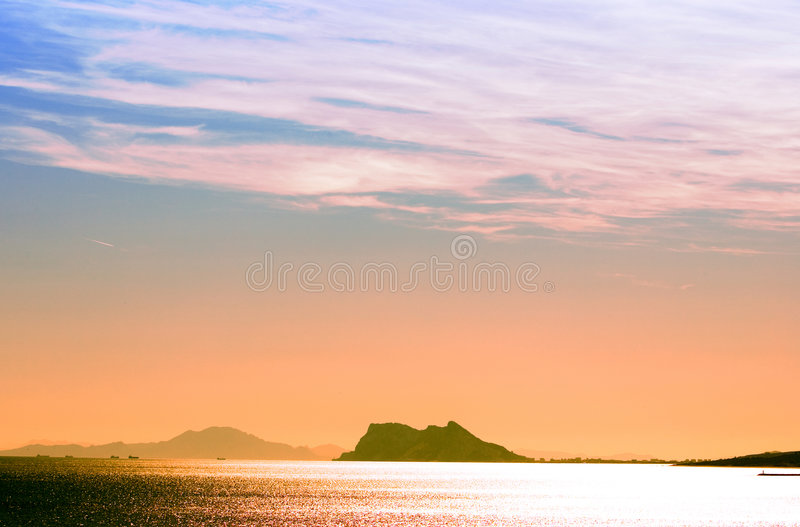 Sunset over the Mediterranean Sea with Gibraltar royalty free stock images