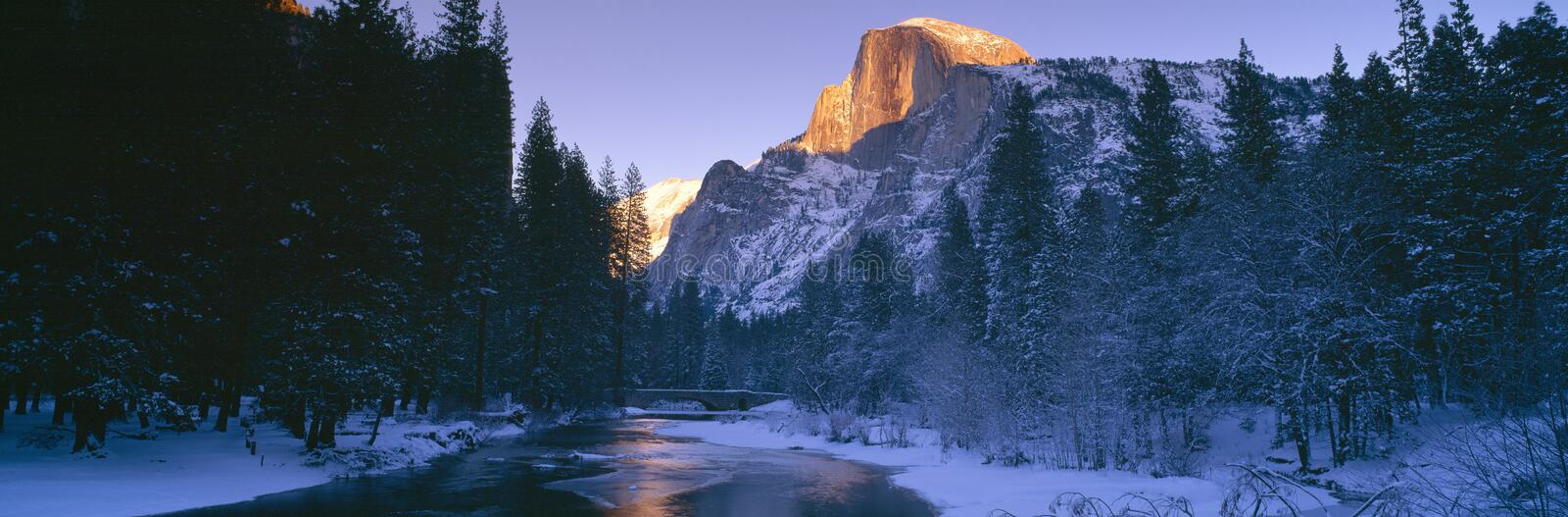 Sunset over Merced River and Half Dome, Yosemite, California royalty free stock image