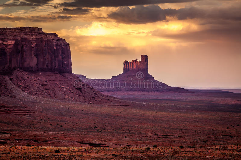 Sunset over the mesas. Rasing light on the mesas before the sunset in Monument Valley stock photos
