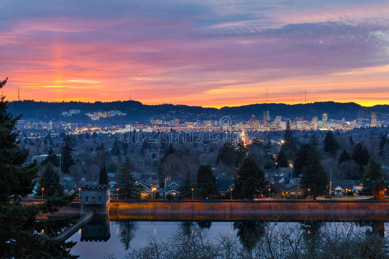Sunset over Mount Tabor Reservior Portland Oregon. Colorful sunset over Mt Tabor City Park Reservior and the skyline of Portland Oregon downtown royalty free stock photos