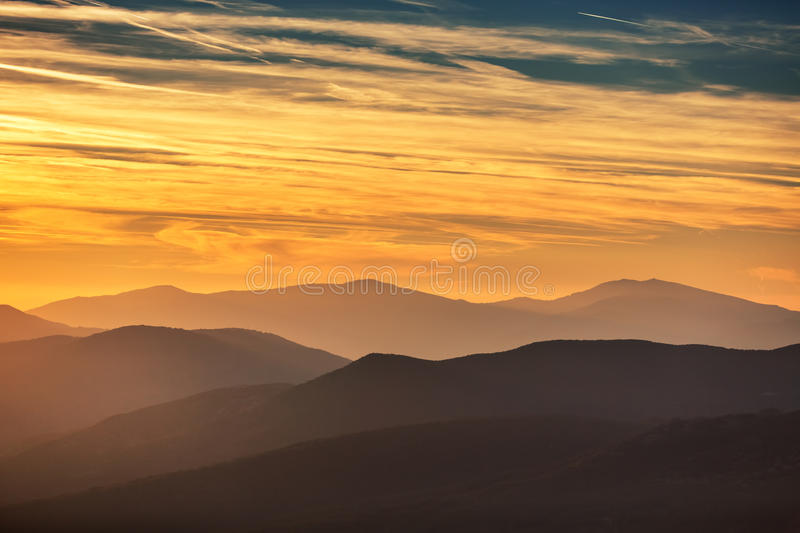 Sunset over the mountain royalty free stock photo