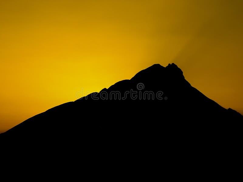 Sunset over Mountain. Bright yellow sunset over Cerro de la Silla mountain, at Monterrey, Mexico stock photography