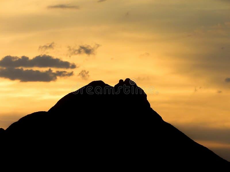 Sunset over Mountain. Bright yellow sunset over Cerro de la Silla mountain, at Monterrey, Mexico royalty free stock photos