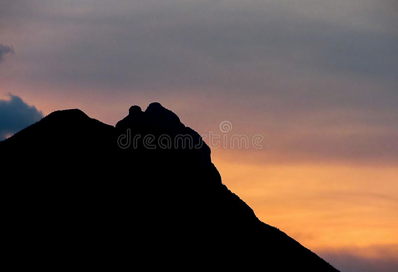 Sunset over Mountain. Bright yellow sunset over Cerro de la Silla mountain, at Monterrey, Mexico stock image