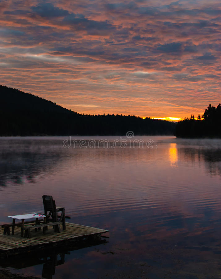 Sunset over a mountain lake. stock photo