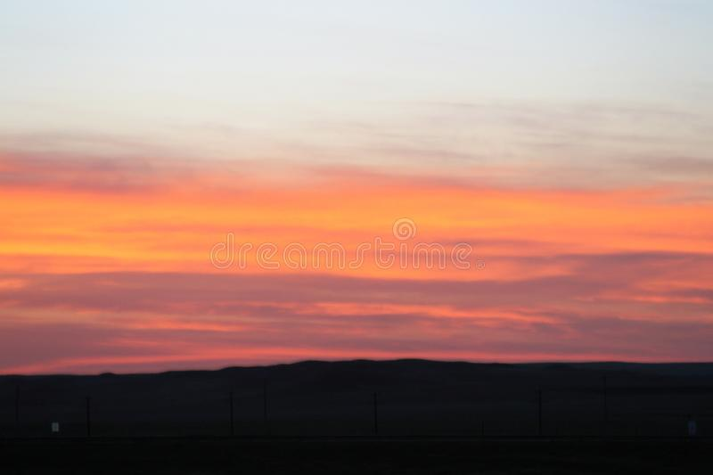 Sunset over mountains golden peach and yellow stock photo