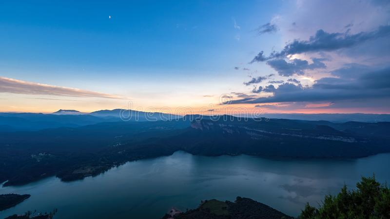 Sunset over the mountains and a lake. stock image