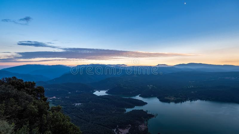Sunset over the mountains and a lake. Blue colors and a lot of peaceful silence. Sau reservoir, Catalonia, Spain stock images