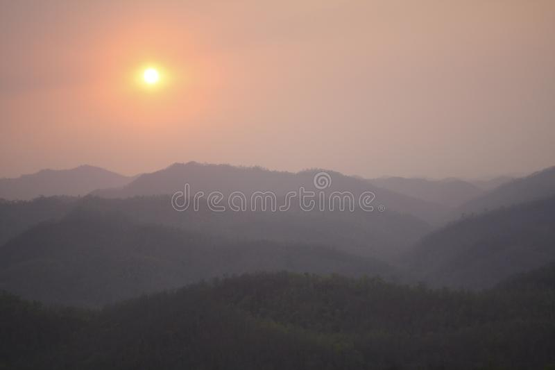 Sunset over mountains in Myanmar. Seen from Thailand royalty free stock image