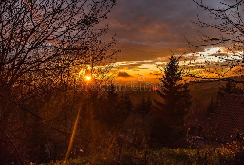 Sunset over the mountains royalty free stock image