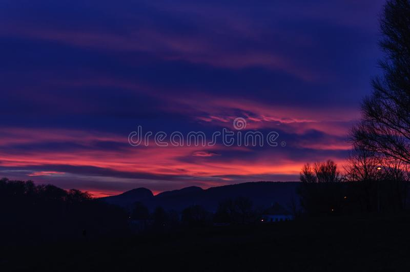 Sunset over Mountains. Night dark blue and pink sky royalty free stock photo