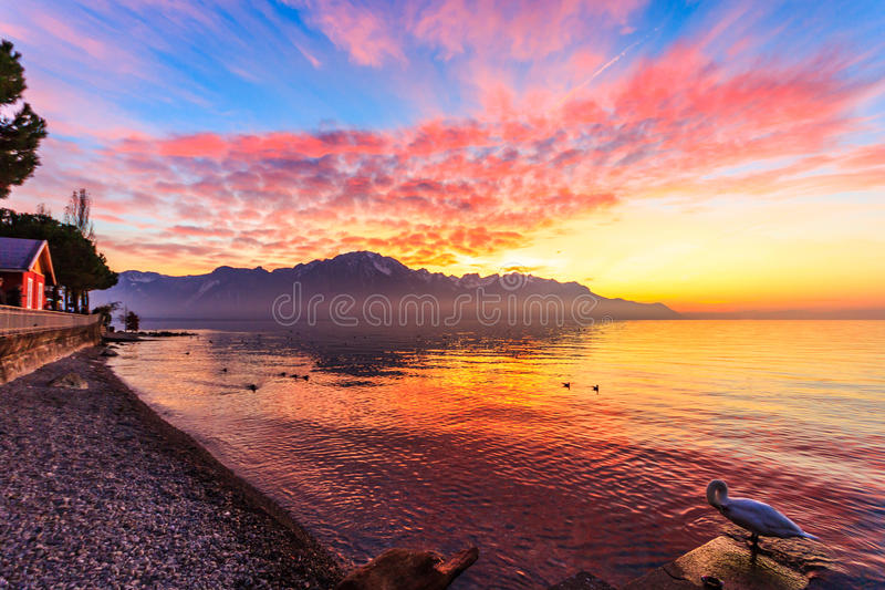Download Sunset Over A Mountains Range Reflecting In A Lake Stock Photo - Image: 83715433