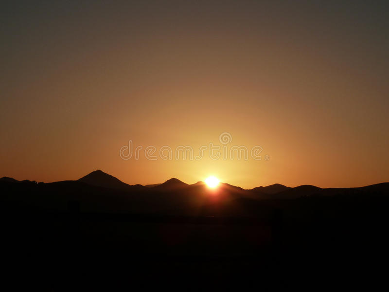 Sunset over the mountains. Romantic sunset over the mountains stock photo