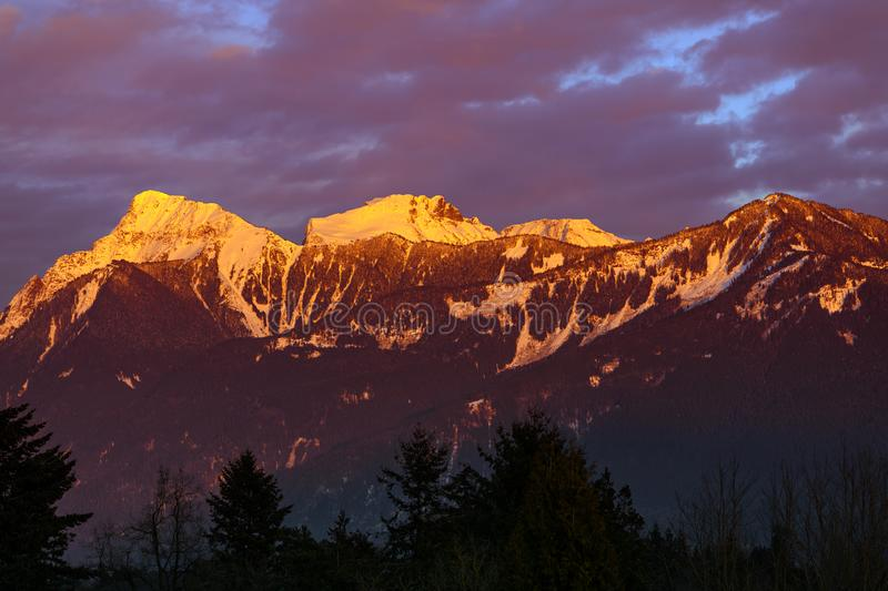 Mt. Cheam at sunset, Chilliwack, British Columbia, Canada. Sunset over the Mt. Cheam, Chilliwack, British Columbia, Canada royalty free stock images